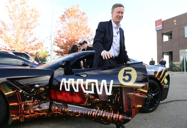 BROOMFIELD, CO - OCT. 27: After a test-drive, Gov. Hickenlooper gets out of the Arrow Electronics Corvette and heads out to test the driverless BMW all-electric 2016 7-series. In coordination with the upcoming Transportation Matters Summit 2015 being held Oct. 28, Gov. John Hickenlooper test drives several electric and driverless cars in Broomfield on Tuesday, Oct. 27, 2015. (Photo by Kathryn Scott Osler/The Denver Post)