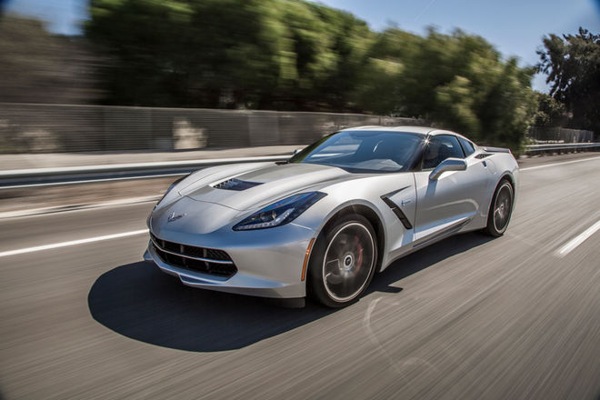 2015-Chevrolet-Corvette-Stingray-Z51-front-three-quarter-in-motion-02